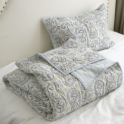 Ballard Designs - Paisley Hand Blocked Quilted Bedding - Pair it with our Paisley Hand Blocked Sham. Coordinates with our Scalloped Linen, Hailey Ruffled & Amelie Embroidered bedding. The soft pattern of our Lille Paisley Quilt is layered by artisans using dye-dipped, carved wooden blocks. Nicely weighted for cool summer nights, it's hand made of 100% cotton with coordinating solid reverse. Paisley Quilt features: . .