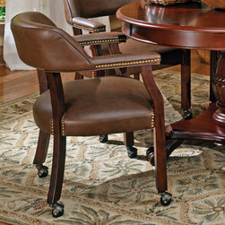 """Steve Silver - Tournament Arm Chair With Casters - The Classic Cherry Gaming Table Set has an attractive Cherry finish that will make a lovely addition to your home bar, billiards room or game room. Features include highly detailed woodworking, intricate carvings. Each of the matching brown chairs features detailed craftsmanship, casters which provide mobility, comfortable padded seats and backs that have decorative nail head trim and are upholstered in a durable leather that is easily cleaned. The Game table top is sold separately that includes poker chip and drink holders with an upholstered top for playing the ultimate games.;Features: Multi-Step Rich Cherry Finish;Traditional Style;Corner Block Construction on Chairs and Table;Tongue and Groove Joints;18"""" Seat Height;Weight: 27 lbs.;Dimensions: 25""""L x 25""""W x 31""""H"""