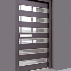 Custom Door - This grey custom modern door design  features a beautiful Italian laminate with glass insets from top to bottom. The width of the door is a little wider than the standard, for a dramatic effect. This is a perfect addition to wide or sweeping hallways with interior doors.