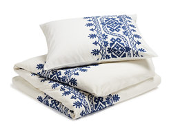 """Coyuchi - Aari Embroidered Duvet Cover, White with Royal Blue, King - Lavish hand-guided embroidery frames the bed in texture and color. The intricate pattern of leafy, blooming vines is set against pure white cotton for a look that's festive and fresh. Designed with an 8"""" interior flap and inside ties. Hidden coconut shell buttons."""