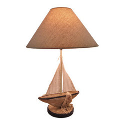 Sailboat Table Lamp with Linen Shade 24.5 In. - This sailboat table lamp is the finishing touch to rooms with beach or nautical themes. It features a wooden sailboat with cloth sails, complete with a rope fishing net hanging over the side with tiny shells tangled in it. The lamp measures 24 1/2 inches tall and has a 16 1/4 inch diameter linen shade. It uses a 40 watt (max) type A bulb (not included), and has a black 4 foot long power cord with a thumb wheel on/off switch. This lamp is a wonderful addition to the homes of sailing enthusiasts, and is sure to be admired.
