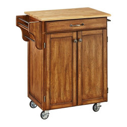 HomeStyles - 32.5 in. Kitchen Cart in Cottage Oak Finish - Prepare your food in style with this mobile kitchen cart! It features a natural wood top with an easy to clean surface, a cabinet with adjustable shelf, an easy open utility drawer and a side rack. It has a rich, cottage oak finish. * Natural wood top. Utility drawer. Two cabinet doors open to storage with adjustable shelf inside. Handy spice rack. Towel bar. Heavy duty locking rubber casters for easy mobility and safety. Two of the casters lock. Finish helping to protect against wear from normal use. Made from Asian hardwood. Made in Thailand. Assembly required. 32.5 in. L x 18.75 in. W x 35.5 in. HHome Styles' Creat-a-Cart is a unique and refreshing solution for kitchen utility.