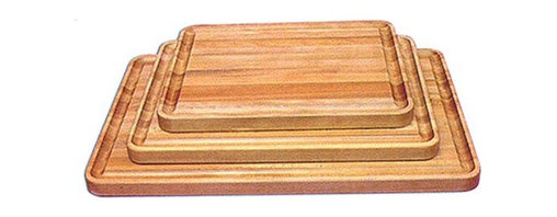 Catskill - Professional Cutting Board with Juice Groove Multicolor - 1322 - Shop for Cutting Boards from Hayneedle.com! The Professional Cutting Board with Juice Groove is made from oil-finished natural yellow birch hardwood which is indigenous to the Northeastern U.S. and ranges in color from blond to a darker walnut shade; the natural variation in color allows this board to coordinate with your existing decor. This board is 1.5 inches thick and can stand up to the most grueling of work loads. A juice groove runs around all four sides of the board keeping your countertop clean and your food where it needs to be. This board is reversible and comes in your choice of sizes. Catskill Craftsmen's Eco-friendly PracticesCatskill Craftsmen is committed to protecting the environment through responsible forest management and manufacturing practices. Located in the Catskill Mountains of upper state New York Catskill Craftsmen plays a role in maintaining the health of the New York City watershed. This watershed provides clean water for New York City and other communities in the area. Healthy well-managed forests are better able to filter pollutants from entering streams and rivers which preserves the quality of watershed resources. With this goal in mind the company supports the efforts of the Watershed Agricultural Council (WAC). With the WAC Catskill Craftsmen encourages lumber suppliers (family forest owners and public land managers) to make wise harvesting decisions and control erosion in order to safeguard water quality. Other efforts to protect the environment include using sustainable wood sources and reducing wood waste. Catskill Craftsmen's manufactured items are made from naturally self-sustaining non-endangered North American hardwoods primarily birch and hard rock maple. All sawdust shavings and waste materials generated during the manufacturing process are converted into wood pellet fuel used to heat homes. This alternative heating source creates less ash and lower emissions than some other fuels. By operating their own wood pellet mill Catskill Craftsmen reduces their wood waste to zero. As natural resources become even more valuable Catskill Craftsmen will continue to advance proper stewardship of the pristine Catskill Mountain region. About Catskill CraftsmenFor over 60 years Catskill Craftsmen has provided customers with high-quality domestic hardwood ready-to-assemble products. Located in Stamford New York Catskill Craftsmen manufactures kitchen carts islands work centers gourmet butcher block chopping blocks cutting boards hardwood cabinets furniture book carts and racks. Catskill Craftsmen is recognized as the nation's leading manufacturer of premium wooden products.