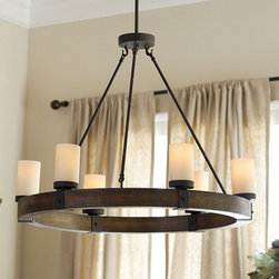 Ballard Designs - Arturo 6-Light Round Chandelier - This light fixture is rustic, but also contemporary. The wood and metal remind me of something I would find in my grandpa's barn. It's perfect for farmhouse style.