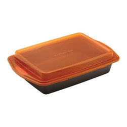 Rachael Ray - Rachael Ray Bakeware Covered Cake Pan Multicolor - 57994 - Shop for Cake Pans from Hayneedle.com! No more transferring that sheet cake or casserole to a portable container - with the Rachael Ray Bakeware Covered Cake Pan you can just pop on the lid and go. Perfect for holiday dinners and potlucks this cake pan is crafted of carbon steel that resists warping and offers a durable nonstick surface for superior food release. The plastic lid snaps right onto the pan and its orange hue a Rachael Ray signature matches the rubberized grip handles on the pan. Both pan and lid are dishwasher safe. Pan is oven safe to 450F degrees.About Rachael RayThis collection of fun functional colorful cookware is inspired and endorsed by TV personality Rachael Ray. Express yourself through your cookware with these truly unique pieces made with high-quality materials like cast iron and bright enamel exteriors. These hard-working pieces are perfect for all types of cooks from casual home users to commercial chefs and you'll love the way they look in your kitchen.About Rachael RayThis collection of fun functional colorful cookware is inspired and endorsed by TV personality Rachael Ray. Express yourself through your cookware with these truly unique pieces made with high-quality materials like cast iron and bright enamel exteriors. These hard-working pieces are perfect for all types of cooks from casual home users to commercial chefs and you'll love the way they look in your kitchen.