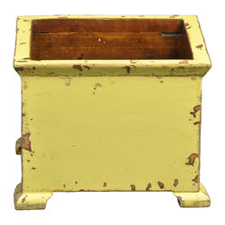 Antique Revival - Butter Tuilleries Planter - This wooden, European-style square planter with small, stub legs looks perfect in any kitchen or on a patio. The bright butter yellow paint adds a great splash of color, and the lightly distressed exterior and natural wood interior evoke an old-fashioned vibe. Item is newly made.