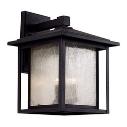 Trans Globe Lighting - Black Three-Light 16-Inch High Outdoor Wall Lantern - - Sheets of seedy glass windows provide open ambience. Decorative lantern with pitched roof and over-hang sides for a peaceful garden setting. Opening at bottom allows light to filter down to area below. Simple geometric design  - Cast aluminum square frame with glass panels  - Securely attached to wall by bracket in back  - Bulb is not included  - Glass: Clear Seeded Glass Trans Globe Lighting - 40362BK
