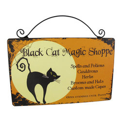 `Black Cat Magic Shoppe` Wooden Wall Plaque - Turn your house into the `Black Cat Magic Shoppe` next Halloween with this adorable wall plaque. It advertises some of the magical things you may have for sale and special hours (evenings until dawn, of course!) The sign is made of wood and measures 10 inches long and 8 1/2 inches tall, including the wire hanger.