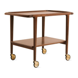 "Moller - Møller Trolley - To satisfy customers' requests for a classic trolley, DWR worked with Møllers to bring the iconic Møller Trolley (1952) back into production. The Trolley can be used as a bar, serving trolley, occasional table or even a printer stand in an executive office. To make the solid walnut frame, Møller hand-selects raw wood from environmentally friendly sources and never uses machines for the final polish, as these devices treat all wood the same and can't replicate the finish that comes from polishing by hand. Founded in 1944 by Niels Otto Møller, J.L. Møllers Møbelfabrik is located in Denmark and has received many awards, including the Danish Furniture Prize in 1974 and 1981. ""My father never compromised on anything,"" says Jørgen Henrik Møller. ""When he designed a chair, he would find the materials and then design the furniture. Each design took him five years to complete."" In 1974, Niels Otto Møller began exporting to Japan, which remains one of the biggest markets for his chairs due to their simplicity and craftsmanship. Møllers is still a small family-owned business and is now managed by Jørgen Henrik Møller. This Trolley is an authentic, fully licensed product of J.L. Møllers Møbelfabrik. Made in Denmark. DWR Exclusive To see more of our top pinned items, click here."
