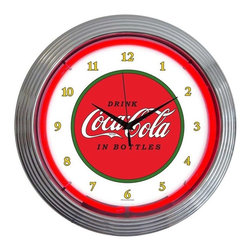 Neonetics - Coca-Cola 1910 Classic 15-inch Neon Clock - Check out this AWESOME neon clock. It has a hand-blown ring of real glass neon that generates 25 watts of bright, colorful light. Features a glass face finished in chrome or black with multi-tiered art deco-style rim, and quartz movement clock. It's perfect for your Man Cave, Game Room, Office or anywhere you want to show love for your favorite things! Includes AC adapter for plug-in power. Clock requires one AA battery which is not included. Measures 15 inches around. Double-boxed for safe shipping.