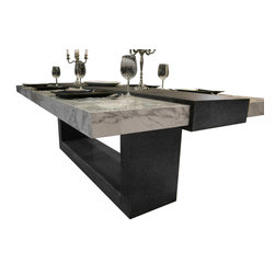 Stone Table - The beautiful polished marble table top is held in place by a raised band of black brushed textured granite that wraps round the end of the table & continues on the underside to meet the leg and base creating a continuous loop.