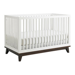 Ti Amo - Ti Amo Moderna Island Crib - White and Espresso - Vintage styling with modern appeal the Ti Amo Moderna Island Crib - White and Espresso is a great centerpiece for any nursery. The round spindles and platform style base add an urban edge to this classic crib. Parents will appreciate the versatility of being able to position this crib in the center of a room or next to a wall. Coordinates beautifully with the Ti Amo Changing Station. Dimensions 36 x 54.5 x 30. Weight 61 lbs.