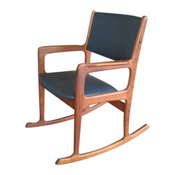Used Benny Linden Teak Mid-Century Modern Rocker - This stunning Mid-Century Modern style rocker was professionally refinished, and it shows. Designed by Benny Linden, it's in a warm teak with new deep gray vinyl upholstery on the seat and back. Overall, it's in excellent vintage condition.