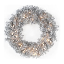 East West Basics (HK) Ltd - 24 in. Classic Silver Pre-lit Wreath - TI920-S300BE-50LC - Shop for Holiday Ornaments and Decor from Hayneedle.com! The 24 in. Classic Silver Pre-lit Wreath is bursting with holiday cheer. This shining silver wreath illuminates any room hallway or entryway. Fifty pre-strung lights eliminate the need for messy wires making it easy to light up any room in your home. Lighting this festive piece up is as easy as plugging it in with the standard three-prong plug.