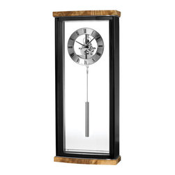 Bulova - Landon Wall Clock - Olive ash burl veneer top and base, high gloss piano finish. Matte black sides. Polished chrome inlaid accents. Chrome-finish metal skeleton movement with tube-style pendulum. Mirror border. Removable clear acrylic back panel. Protective curved glass lens. Uses two AA batteries, not included. Bulova - C3388