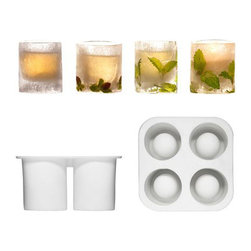 Icy Shot Glass Mold - Set of 3 - The Swedes have done it again. This time, they're upping your shot glass experience a few notches with the Icy Shot Glass Mold. You simply fill the mold with water, place it in the freezer overnight, and you have unique, ice-cold glasses for your next grown-up gathering. Three molds included (each makes four glasses).