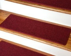 """Dean Flooring Company - Dean Non-Slip Tape Free Pet Friendly DIY Carpet Stair Treads/Rugs 27"""" x 9"""" (15) - Dean Non-Slip Tape Free Pet Friendly DIY Carpet Stair Treads/Rugs 27"""" x 9"""" (15) - Color: Red : Quality, Stylish Carpet Stair Treads by Dean Flooring Company. Extend the life of your high traffic hardwood stairs. Reduce slips/increase traction. Cut down on track-in dirt. Great for pets and pet owners. Made in the USA from quality, long lasting stain resistant olefin carpeting with non-slip padded foam backing. Stands up great to high traffic. A fresh new look for your staircase. Do-it-yourself installation is quick and easy with our unique non-slip backing. Simply place your stair tread rugs on your staircase and go. No tapes, adhesives, staples, glue, or Velcro needed. And rest assured, they won't move and they won't damage your hardwood either. They are also simple and easy to remove as well with no sticky residue left behind. Each tread is bound with color matching binding tape. No bulky fastening strips. You may remove your treads for cleaning and re-attach them when you are done. Add a touch of warmth and style to your stairs today with new stair treads from Dean Flooring Company! We make our own stair treads at Dean Flooring Company and our products are not available from anyone else."""