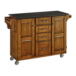 HomeStyles - Wood Kitchen Cart in Cottage Oak Finish - Enjoy timeless style with this large kitchen utility cart! It features a sleek, black granite top with a smooth and easy to clean surface, this piece has a rich, cottage oak finish for the utmost mobility and the best in style. * Black granite top. Solid wood construction. Four easy open utility drawers. Two cabinet doors open to storage with adjustable shelf inside. Handy spice rack with a towel bar. Paper towel holder on other side. Heavy duty locking rubber casters for easy mobility and safety. Clear coat finish helps to protect against wear from normal use. Made from Asian hardwood. 48 in. L x 17.75 in. W x 35.5 in. H. Top Assembly Instruction