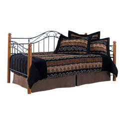 Hillsdale - Hillsdale Winsloh Metal and Wood Post Daybed in Oak Finish-Daybed - Hillsdale - Daybeds - 123DBLHTR - The Hillsdale Winsloh Daybed features metal and solid hardwood construction. The metal panels have a textured black finish and the wood posts are medium oak. This twin size daybed has gracefully flowing scrollwork and sturdy wooden posts with round finials. A mattress supporting suspension deck is included. Extend its versatility by using it as a sofa in the home office or combining it with the optional roll-out trundle in the guest room for even more sleeping space. The convenient and space saving optional roll-out trundle fits a standard twin size mattress and includes six casters for easy setup. With stylish curves and an elegant two tone finish, the Winsloh Daybed is a perfect addition to any room in your home.