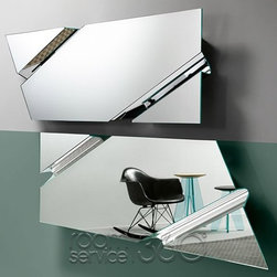 The Wing mirror by Daniel Libeskind  for Fiam Italia - The Wing contemporary mirror is a a masterpiece with intensity and dimension that reimagines reflection through its unusual surface.  Designed by the brilliant Daniel Libeskind whose accolades include the Ground Zero master-plan, The Wing collection is manufactured in Italy by Fiam and is available elliptical, rectangular and trapezoid shapes with various sizes.