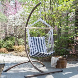 Island Bay Navy and White Stripe Padded Sling Hammock Chair with Steel Stand - While away the hours this summer while seated comfortably in the Island Bay Navy and White Stripe Padded Sling Hammock Chair with Steel Stand. In addition to being suspended weightlessly in the air you'll love the thick padded chair made from layers of polyester. Its navy and white-striped fabric easily complements most decor and adds a touch of classic beauty to your yard. A durable wood spreader bar keeps the chair open so you can easily get in and out of the chair. The strong and sturdy steel stand in your choice of finish supports the hammock while a durable rope and hanging ring is included so you can immediately hang the chair grab a cold drink and your favorite book for a comfortable afternoon spent outdoors. About Island Bay HammocksIsland Bay brings you well-designed authentic hammocks and accessories from around the world. From the East Coast to the West Indies the hammock is recognized as the ultimate getaway so we've dedicated ourselves to getting it right. You'll find eye-catching colors and patterns comfortable outdoor designs and heavy-duty stands designed to keep you swinging peacefully. It's your world ... relax in the real thing.