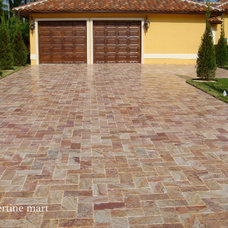 Traditional Garage And Shed by Travertine Mart