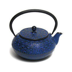 Komon-Sakura Japanese Tetsubin Iron Teapot - Tea just has to taste better poured from this beautiful teapot. The cherry blossom pattern and the deep blue shade are gorgeous.