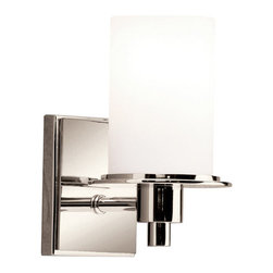 Kichler 1-Light Wall Fixture - Polished Nickel - One Light Wall Fixture The classic bath bar receives a bold and inspiring contemporary design that will certainly bring out the best in your bathroom. Featuring the bright sheen and high quality of our polished nickel finish, this 1-light wall sconce offers a clean allure to any bathroom. Satin-etched cased opal glass covers a 100-watt bulb for powerful lighting. The fixture measures 5 wide, 8 high, and is U. L. Listed for damp location.