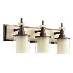 Quorum Lighting - Quorum Lighting Concord Transitional Bathroom / Vanity Light X-68-3-4605 - You definitely can't go wrong when decorating with this Quorum Lighting Concord Transitional Bathroom/Vanity Light. It features a frame in a rich and warm, oiled bronze finish with a long, rectangular back plate and three clear glass shades. It's an amazing, 24-inch-long piece which will certainly gain praise and admiration from anyone who sees it in your bathroom.