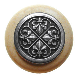 "Inviting Home - Fleur-de-Lis Natural Wood Knob (unfinished with antique pewter) - Fleur-de-Lis Natural Wood Knob unfinished with hand-cast antique pewter insert; 1-1/2"" diameter Product Specification: Made in the USA. Fine-art foundry hand-pours and hand finished hardware knobs and pulls using Old World methods. Lifetime guaranteed against flaws in craftsmanship. Exceptional clarity of details and depth of relief. All knobs and pulls are hand cast from solid fine pewter or solid bronze. The term antique refers to special methods of treating metal so there is contrast between relief and recessed areas. Alternate finishes are available. Detailed Description: The Fleur-de-lis means ""flower of the lily"" It was used to represent French royalty. It was said that the king of France Clovis who started using the symbol of the Fleur-de-lis because the water lilies helped guide him to safety and aided him in winning a battle. The design in the Fleur-de-Lis pulls is arranged in alternating positions of the Fleur-de-lis. These pulls are a great match for the Fleur-de-lis knobs which have the Fleur-de-lis pattern arranged in a circle. The different shapes of decorative hardware make the cabinet doors and drawers interesting to look at."
