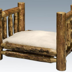 Montana Woodworks - Log Small Pet Bed - Includes fleece lined mattress. Hand crafted. Heirloom quality. Solid lodge pole pine accents. Made from American grown wood. Stained and lacquered finish. Made in USA. Assembly required. Mattress: 16 in. W x 24 in. H. 26 in. L x 21 in. W x 17 in. H (26 lbs.). Warranty. Use and Care InstructionsMontana Woodworks incredibly popular pet bed allows your pet to snuggle into a luxurious, fleece lined mattress for a comfortable healthy rest. The artisans at Montana woodworks use the mortise and tenon joinery system to ensure this item will withstand years of use. Handcrafted by the artisans of Montana woodworks, The glacier country collection features a truly unique finish reminiscent of the grand lodges of the Rockies, circa 1900. Craftsmen remove the outer bark using old-fashioned draw knives while leaving the inner cambium layer intact for increased texture and contrast. The process is completed in a professional eight step process that applies stain and lacquer for a durable, low maintenance finish. Dark, rich hues and tones provide an extraordinary appearance!