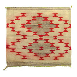 """Consigned Antique Navajo Bowtie Mat - An early 20th century Navajo textile mat in the Gallup throw-style, with red and grey bowtie decorations on a cream background with lime green selvedge. It is stamped in the corner """"188599"""" on one side. There is one stable hole and the red dye has bled in places as pictured. It would make a great tabletop textile or could easily be sewn into a large throw pillow."""