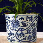 Blue and White Open Lotus Design Vase / Planter - Hand painted and simply elegant, the Lotus planter is a nod to the blue and white trend that is ever popular this season. Made of delicate and beautiful porcelain in rich hues of blue and pure white. This jar is adorned with stunning lotus flowers and is perfect for placing your favorite houseplant in and setting it near a kitchen or dining room window.