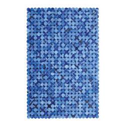 Madisons Inc. - Blue Circles Modern Cowhide Rug, 5' X 8' - The Blue Cowhide Rug is a natural hair-on-hide area rug that has been made in India. Small circles of natural cowhide lay over small dark blue diamonds adding a dramatic flair and striking ornamentation to any space. This rug is reserved for those who relish high design and style, as it is made by highly-skilled artisans. The cowhide has been ethically sourced in India and tenders shorter hair than those from other parts of the world as a result. Not only does this piece make a statement, but sustains the livelihood of many villages in India from which they are produced.