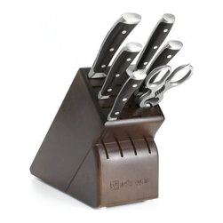 Wusthof - Wusthof Ikon Blackwood 7 Piece Knife Block Set - This Wusthof Ikon Blackwood 7 piece knife set includes the following items: 3.5 inch paring knife, 4.5 inch utility knife, 8 inch cook's knife, 8 inch bread knife, 9 inch sharpening steel, kitchen shears, 17 slot hardwood block. Hand wash only. Lifetime warranty from Wusthof with normal use and proper care. Made in Solingen Germany.Made in Germany