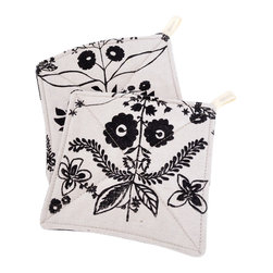 Dala Pot Holders - Set of two potholders from Appetite.  Hand screen-printed natural fabric in black Dala print on one side and re-purposed upholstery samples on the reverse. Lined with a heat shield fabric and batted with natural cotton fill, each one Includes a little loop for hanging. Can also be used as trivets for serving on the table. Note: these potholders are not heat-proof or flame retardant.