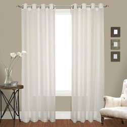 United Curtain Venetian Grommet Curtain Panel Pair - Elegant Italian style is prevalent in the United Curtain Venetian Grommet Curtain Panel Pair. These curtains feature a sheer crushed voile texture with thick top and bottom borders.About United Curtain CompanyUnited Curtain Company is based in Avon, Massachusetts. This company provides quality curtains, window treatments, and slip covers designed to dress your home in style. United Curtain home decor items are made of exceptional fabrics in patterns and colors that range from classic to contemporary. Elegant details paired with sumptuous fabrics or casual prints in comfy cotton duck, United Curtain Company has all you need to create a home that inspires you and showcases your personality.