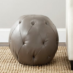 Safavieh Santiago Leather Pouf Ottoman - The Safavieh Santiago Leather Pouf Ottoman is a fun little guy to have around. This unique ball-shaped ottoman still has lots of class to spare, made with bicast leather and a tight button tufting. It is generously stuffed with foam for comfort. It comes in a versatile clay tone, making it feel right at home in any setting. It's even compact enough for the urban studio apartment or posh dorm room.About SafaviehConsidered the authority on fine quality, craftsmanship, and style since their inception in 1914, Safavieh is most successful in the home furnishings industry thanks to their talent for combining high tech with high touch. For four generations, the family behind the Safavieh brand has dedicated its talents and resources to providing uncompromising quality. They hold the durability, beauty, and artistry of their handmade rugs, well-crafted furniture, and decorative accents in the highest regard. That's why they focus their efforts on developing the highest quality products to suit the broadest range of budgets. Their mission is perpetuate the interior furnishings craft and lead with innovation while preserving centuries-old traditions in categories from antique reproductions to fashion-forward contemporary trends.