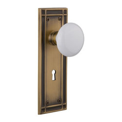 Nostalgic Warehouse - Nostalgic Mission Plate with White Porcelain Knob and Keyhole in Antique Brass - The Mission plate in antique brass harkens to the Spanish Colonial period of the Western frontier, with an instantly recognizable square corner. Add a traditional touch with our pure White Porcelain Knob for a simple, yet vintage, look. All Nostalgic Warehouse knobs are mounted on a solid (not plated) forged brass base for durability and beauty.