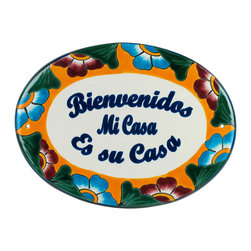 Talavera Welcome Plaque - Welcome your guests with this traditional Mexican greeting. Beautiful and colorful, this plaque includes hang holes on the back for easy wall mounting. Handmade and hand painted by talented Mexican potters. Visit our website for more. Each is unique, so your plaque will likely vary in design and color. Free Shipping in Continental U.S.