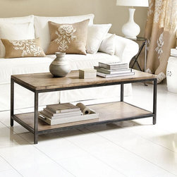 Ballard Designs - Durham Cocktail Table - Generous lower shelf. Planked solid hardwood top. Frame has aged steel finish. Inspired by a vintage bricklayer's table, the clean architectural lines of this metal frame cocktail table work easily with our best-selling sofas. The generous lower shelf offers plenty of room for baskets and display. Heavily distressed planked solid hardwood top is finished with a wash to enhance its rich grain and character. Assembly required.Durham Cocktail Table features:. . .