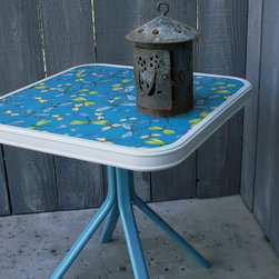 Garden Accents and Accessories - Occasional table with fabric laminate top in cute dragonfly pattern for your patio use will happily hold candles, your drink, and a bowl of chips.   See our website for pricing and more items for sale.