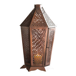 Malibu Creations - Malibu Creations Byzantine Burnished Lantern - Burnished metal, intricate pattern, and fearless design is bound to attract admirers, especially when candlelight is accentuating it all. Open the hinged door of this stunning bronzed metal lantern and set the candle of your choice inside - one strike of a match and you have an exotic and entrancing piece of functional art in your living space. The all-over cutouts create gorgeous light and shadow, and the decorative base adds to the overall beauty. Hang it from the top loop or set it on your tabletop.
