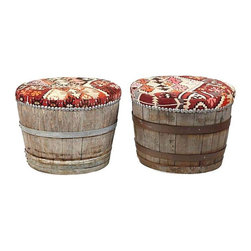 Used Wine Barrel Ottomans - A Pair - Have a wine enthusiast in your family? These are just the seats for them. A pair of wine barrels repurposed as stools. The seats are webbed and upholstered in one-of-kind vintage kilims with pewter nailhead trim that matches existing hardware.