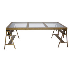 Kathy Kuo Home - Kirk Industrial Style Antique Bronze Trestle Frame Desk - An oversized, impressive desk makes light work of multi-tasking. Whether used as a drafting table, a modern desk or even a display area, this antique bronze industrial piece rises on its trestle frame to any occasion. Three large glass panels provide a beautiful work space.