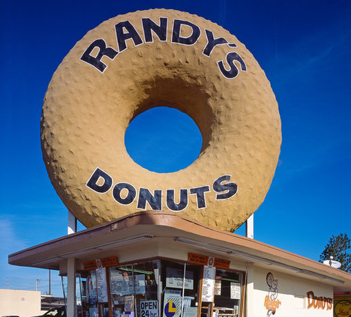 """Randy's Donuts, Inglewood, CA Print - The (1954) sign, as much as the baked goods, is the lure at Randy's Donuts, in Inglewood, California. One roadside-attractions website notes that because of its proximity to an L.A. freeway, the sign gets frequent """"smog and soot scrubs."""" Created with digital capture camera by Carol M. Highsmith, 04/07/05."""