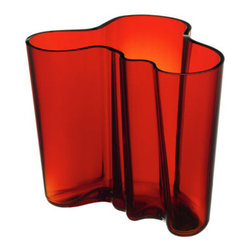 """Aalto Flaming Red Vase - 6-1/4"""" - ntroduce a functional and innovative piece of art into your home. The Alvar Aalto vase has been a sensation since its inception in 1937 and now you can enjoy its simple and elegant beauty. Believed to mimic the wave-like pattern of the Finnish coastline, this organic shape has become iconic. The effect is achieved through the original mouth-blown process by Finland's most achieved glassblowers. This fiery red commands attention and emphasizes the graceful form."""