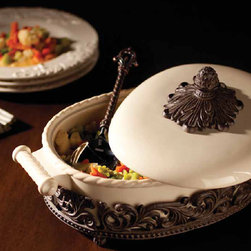 The GG Collection - Covered Casserole Dish - This simple and elegant covered casserole dish with old world styled metal accents is so attractive, well made and easy to use you will want more than one. Use them to add a touch of old world elegance to your next meal. The removable ceramic baker from the GG Collection serving pieces are oven, microwave and dishwasher safe.