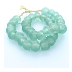 Small Aqua Sea Glass Beads - A loop of small sized frosty sea-glass beads in a delightful shade of aqua, their texture pitted and clouded by wind and waves, fill a knotted strand of natural fiber to make a decorative necklace that looks great draped over a vintage box of treasures, arranged around a pillar candle, or hanging on a shapely vase. This simple designer trick brings a casual, summery feel to a room without the necessity of changing out furniture or other favorite ornaments with the seasons.