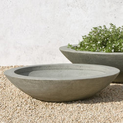 Campania International - Campania International Medium Low Zen Cast Stone Planting Bowl - P-503-AL - Shop for Planters and Pottery from Hayneedle.com! About Campania InternationalEstablished in 1984 Campania International's reputation has been built on quality original products and service. Originally selling terra cotta planters Campania soon began to research and develop the design and manufacture of cast stone garden planters and ornaments. Campania is also an importer and wholesaler of garden products including polyethylene terra cotta glazed pottery cast iron and fiberglass planters as well as classic garden structures fountains and cast resin statuary.Campania Cast Stone: The ProcessThe creation of Campania's cast stone pieces begins and ends by hand. From the creation of an original design making of a mold pouring the cast stone application of the patina to the final packing of an order the process is both technical and artistic. As many as 30 pairs of hands are involved in the creation of each Campania piece in a labor intensive 15 step process.The process begins either with the creation of an original copyrighted design by Campania's artisans or an antique original. Antique originals will often require some restoration work which is also done in-house by expert craftsmen. Campania's mold making department will then begin a multi-step process to create a production mold which will properly replicate the detail and texture of the original piece. Depending on its size and complexity a mold can take as long as three months to complete. Campania creates in excess of 700 molds per year.After a mold is completed it is moved to the production area where a team individually hand pours the liquid cast stone mixture into the mold and employs special techniques to remove air bubbles. Campania carefully monitors the PSI of every piece. PSI (pounds per square inch) measures the strength of every piece to ensure durability. The PSI of Campania pieces is currently engineer